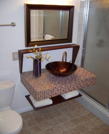 Photo of wall mounted vanity with vessel sink
